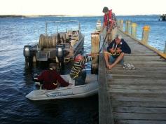 Frazer Reynolds, Steve Lee, Bill Reynolds and John Barry getting ashore at Lady Barron.