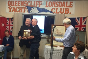 Vice-Commodore Frank receives Cec Anderson Trophy from QCYC Commodore Richard Lowe.