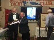 Mayor Bob Merriman awards the new Keelboat trophy to winner (and maker) Tom Hinton