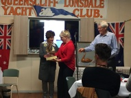 Kaye Barry, accepts Lady Skipper's Trophy from Bev Lee